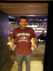 The Boyfriend, blurry, at a Colorado Avalanche hockey game. Yes, he is holding two churros. One is mine. Don't judge.